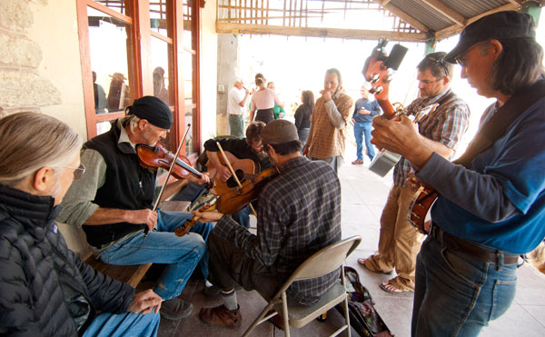 Musicians jam on the porch.